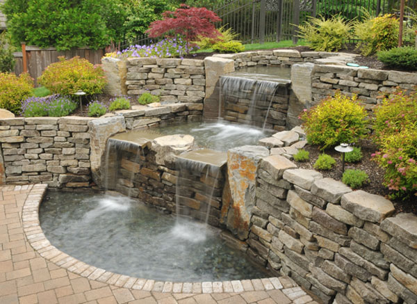 Pond builders commercial pond construction pond and for Fish pond fountain design