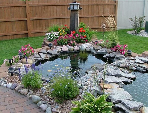 Pond building residential pond builders backyard ponds for Landscaping around koi pond