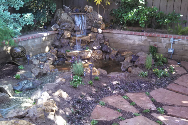Making a nice backyard with a pond pacific ponds for Garden pond design and construction